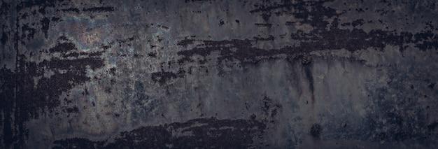 Брутальная металлическая текстура для темного грубого фона. некоторые пятна радуги и ржавчины
