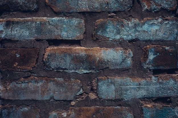 Грубая джинсовая кирпичная стена. винтажная деревенская текстура фон