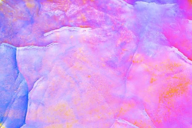 カラフルな割れた氷のテクスチャ。虹色のホログラフィックカラー