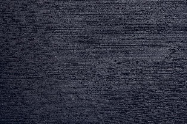 Каменная или бетонная черная или темно-серая текстура фона