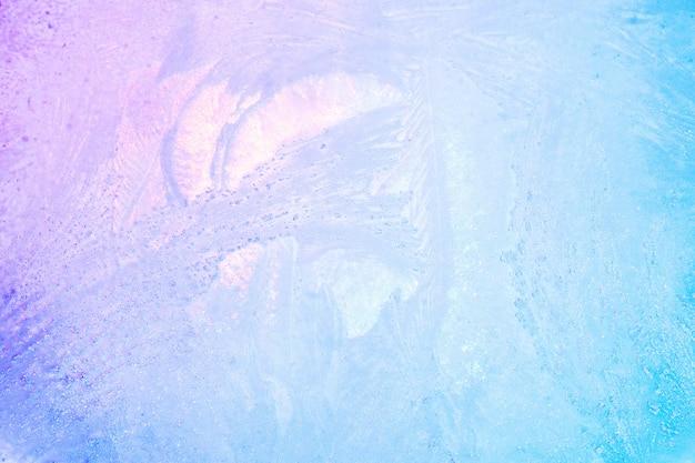 カラフルな氷のテクスチャ背景。冬の虹色のホログラフィック明るい色または夏の飲み物の氷