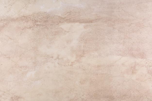 ピンクの色調で抽象的な大理石のテクスチャ
