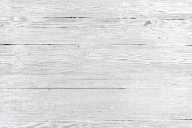 木製のテクスチャと灰色のセメント壁の背景。