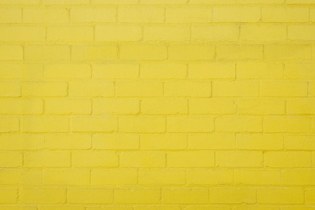 黄色のレンガの壁の背景の質感