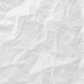 背景のために白くしわが寄せられた紙のテクスチャ