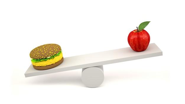 スケールのハンバーガーと赤いリンゴ