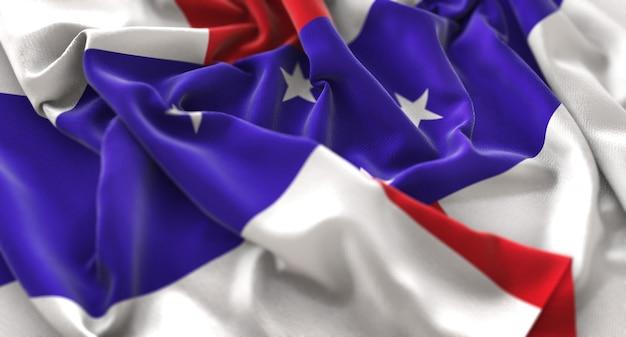 オランダ領アンティル諸島の旗が美しく波打ち際に浮上マクロ接写