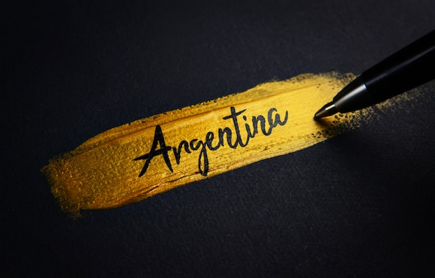 ゴールデンペイントブラシストロークのアルゼンチン手書きテキスト