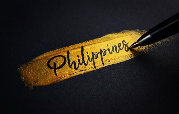 フィリピンの手書きのテキストゴールデンペイントブラシストローク
