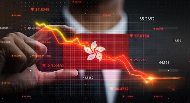 香港の旗の前で落ちるグラフ。危機の概念