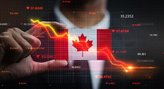 カナダの旗の前で落ちるグラフ。危機の概念