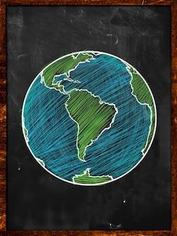 緑色の地球上の黒板の地球