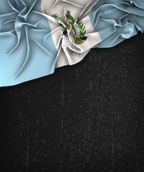 グアテマラの旗ヴィンテージグランジの黒の黒板にテキストのためのスペース