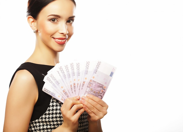 Молодая счастливая женщина с долларами в руке.