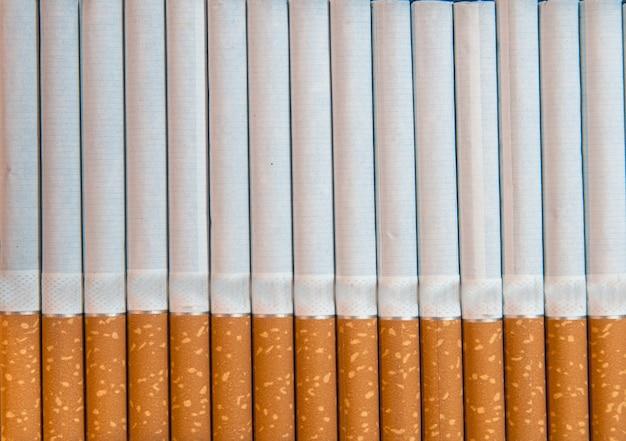 Крупный план табачных сигарет фон или текстура