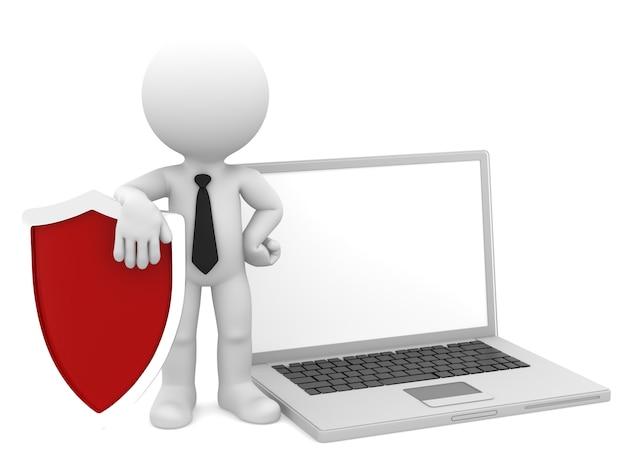 シールドとラップトップを持ったビジネスマン。インターネット/コンピューターのセキュリティの概念。