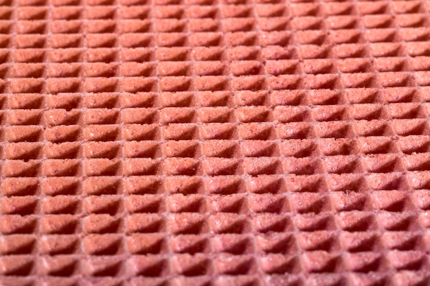 ピンク色の菓子ワッフルの背景と表面の質感