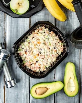 Русский салат и немного фруктов