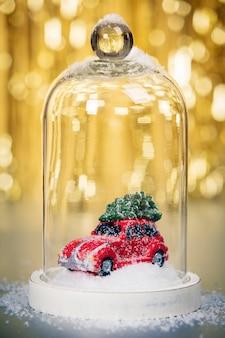 金の抽象的な背景のクリスマスの装飾をクローズアップ