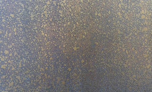 鉄の汚れた黄金の光沢のあるテクスチャ
