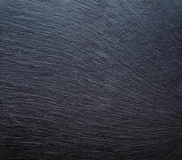 背景の暗い灰色の黒いスレートのテクスチャ