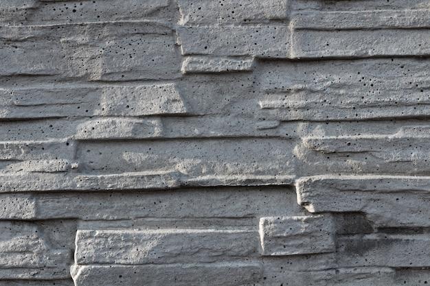 装飾的な白いスレートの石の壁の表面のテクスチャ