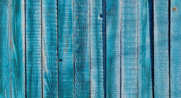 Текстура старой голубой деревянный забор. деревенские деревянные доски для фона.