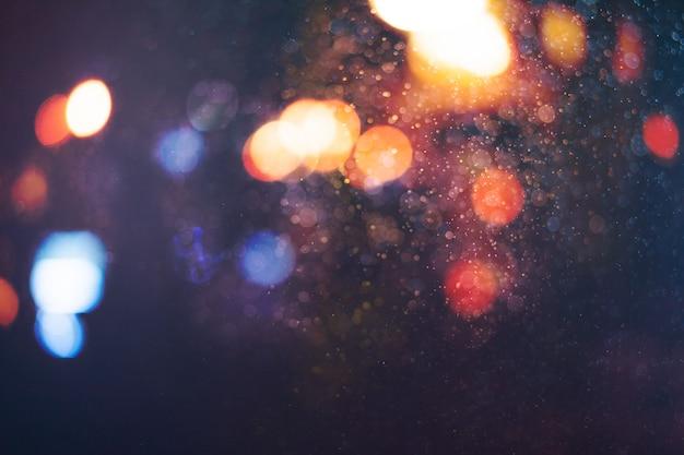 Размытие боке фоне городского ночного света.