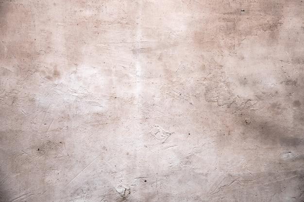 古いグランジ石膏壁。テクスチャー