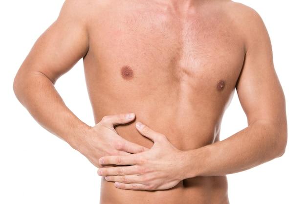胃の痛みを持つ男