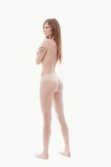 若い女性がトップレス、完璧な肌、背面ビューのポーズ
