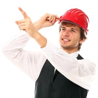 Человек молодого работника с промышленным шлемом