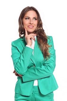 Деловая женщина в зеленом костюме