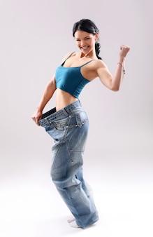 Портрет женщины, показывая ее потеря веса