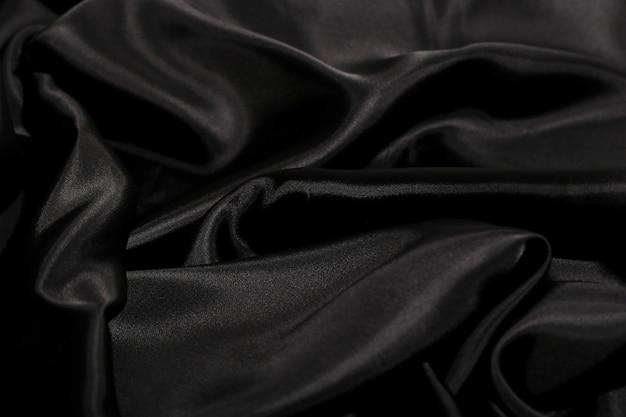 黒のシルク生地のテクスチャ背景