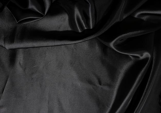 黒のシルク生地の背景テクスチャ