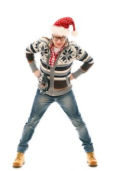 サンタ帽子のポーズを持つ男。クリスマスシーズン