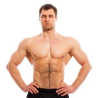 Красивый мускулистый парень с голым торсом