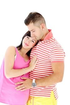 成熟した男と妊娠中の女性は一緒に幸せです