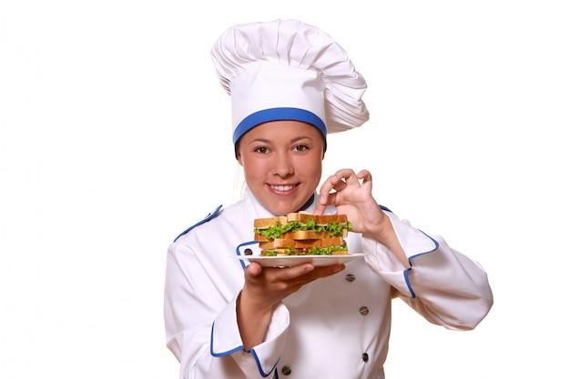 Красивая женщина в образе шеф-повара