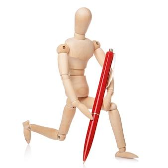 Маленький деревянный манекен и шариковая ручка