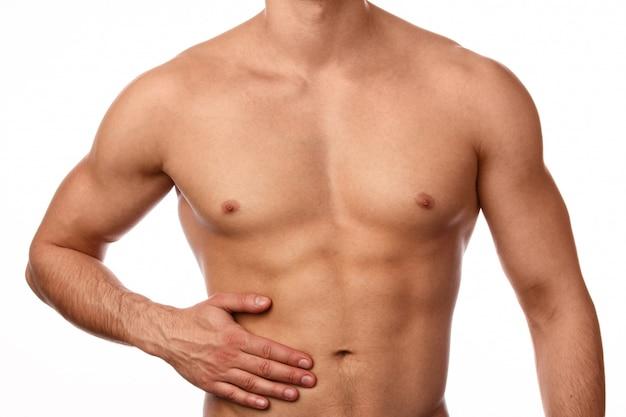 彼の胃の痛みを持つ男