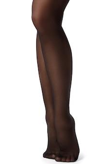 Красивые женские ножки в черных чулках