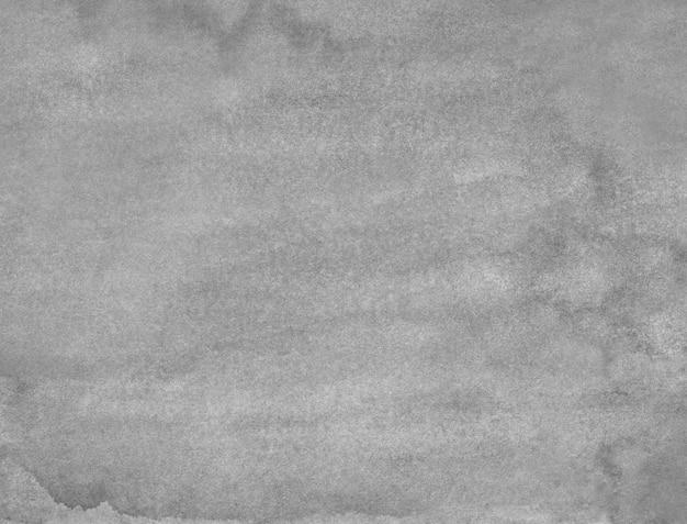水彩の古い灰色の背景の絵。モノクロの穏やかなグランジオーバーレイ。紙のテクスチャに灰色の汚れ。