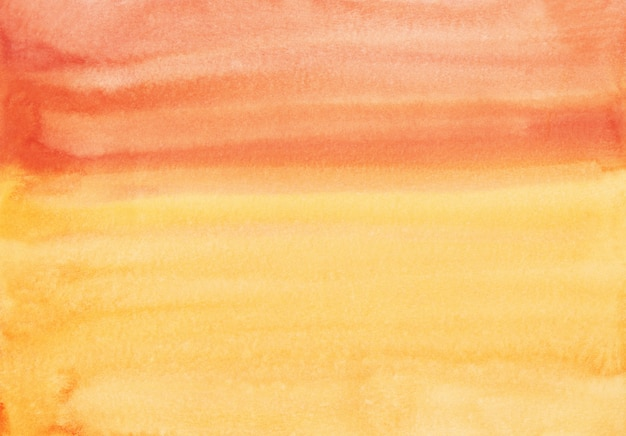水彩の茶色のオレンジと黄色の背景のテクスチャです。カラフルな水の色の背景手描き。