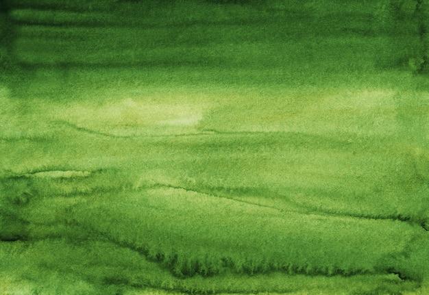 手描きの水彩画の緑の背景テクスチャ。水彩の抽象的な深いトウヒの背景。紙の汚れ。