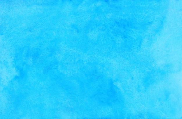 水彩の明るいシアンの背景の絵。水彩の明るいスカイブルーの汚れを紙に。芸術的な背景。