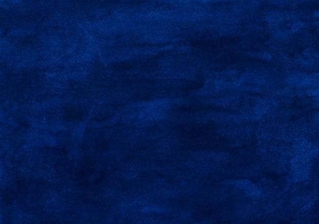 水彩の暗い青色の背景の絵のテクスチャ。ヴィンテージ手描きのディープオーシャンブルー水彩背景。紙の汚れ。