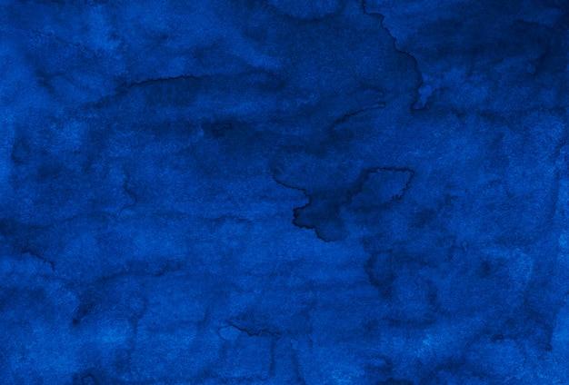 水彩の暗い青色の背景の絵のテクスチャ。ビンテージケンタッキーブルー色の手描きの水彩画の背景。紙の汚れ。
