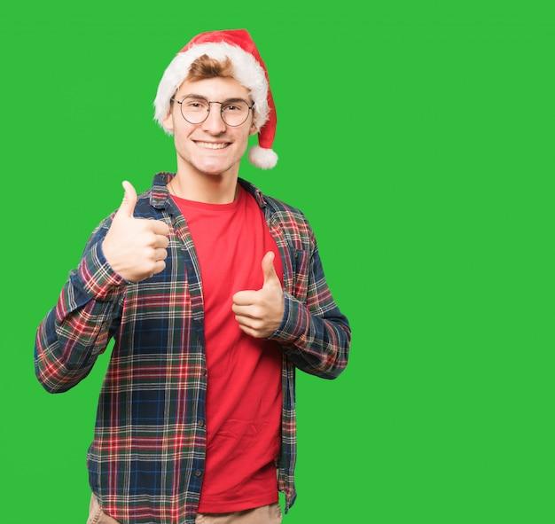 クリスマスのジェスチャーをしている若い男